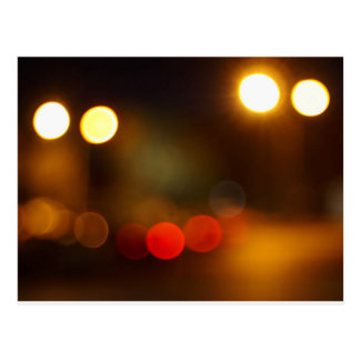 Abstract blurred night scene on city road postcard