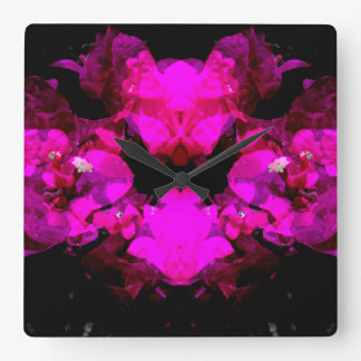 Abstract floral design - bright pink on black clocks