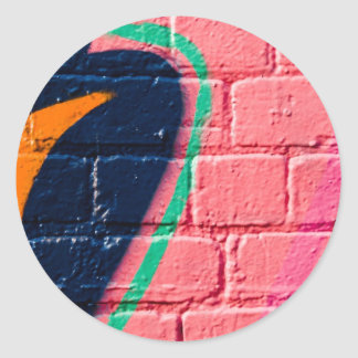 Abstract Graffiti detail on the textured wall Round Sticker