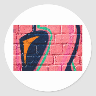Abstract Graffiti detail on the textured wall Round Stickers