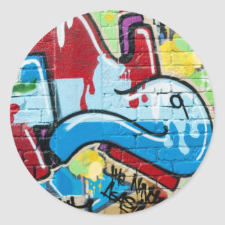 Abstract Graffiti on the Textured Brick Wall Round Sticker