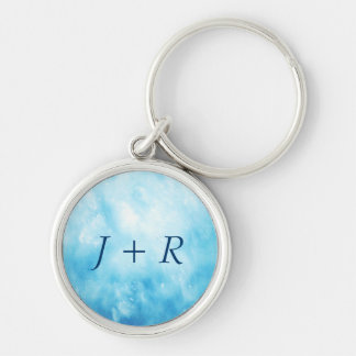 Abstract Hand Drawn Watercolor Background: Blue Silver-Colored Round Key Ring