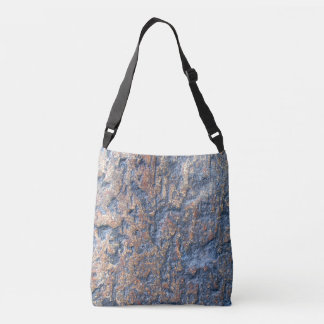 Abstract image of brown stone crossbody bag