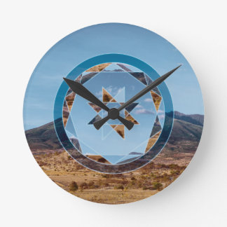 Abstract landscape with geometrical shapes round clock