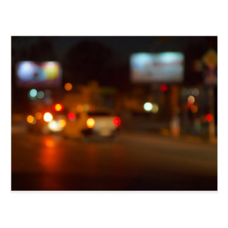 Abstract night scene with blurred headlights postcard