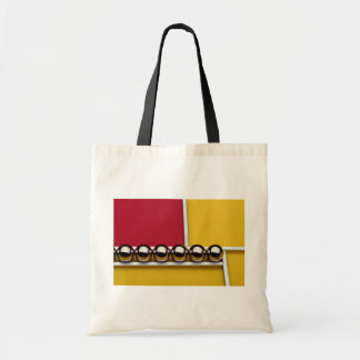 Abstract Steel balls and rods on red and yellow ac Tote Bag