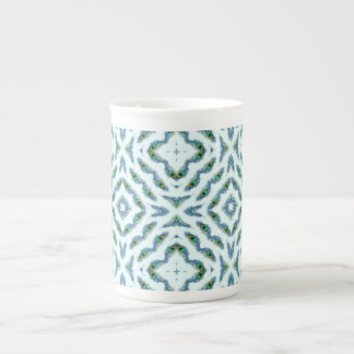 Abstract teal blue black floral peacock feathers. tea cup
