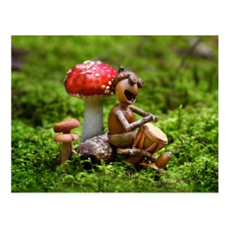 Acorn elf plays on drums sitting on a belly postcard