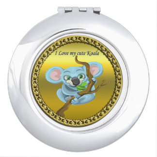 Adorable koala bear in a tree in the forest vanity mirrors
