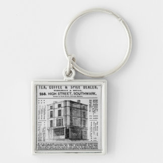 Advertisement for Robert Jones, Tea Silver-Colored Square Key Ring