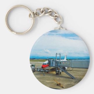 Aeroplane loaded with cargo at a terminal basic round button key ring