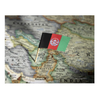 Afghanistan flag in map postcard