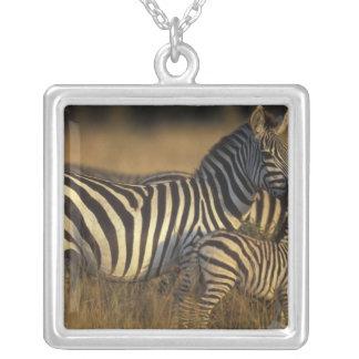 Africa, Kenya, Masai Mara Game Reserve. Plains Square Pendant Necklace