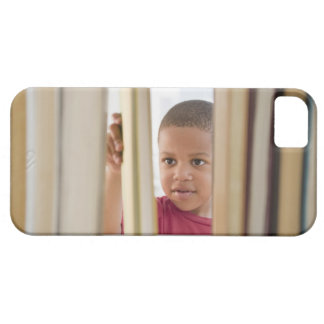 African American boy selecting book iPhone 5 Cases
