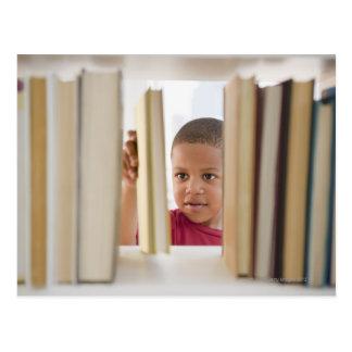 African American boy selecting book Postcard