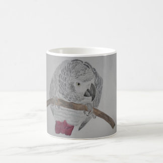 African Grey Parrot hunched over Coffee Mug