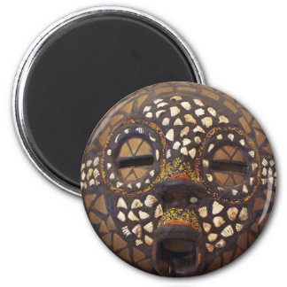 African mask with cowrie shells magnet