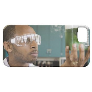 African scientist examining experiment in barely there iPhone 5 case
