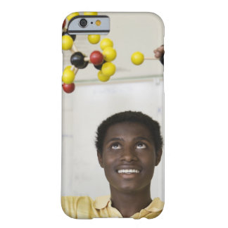 African teenage boy viewing molecule model barely there iPhone 6 case
