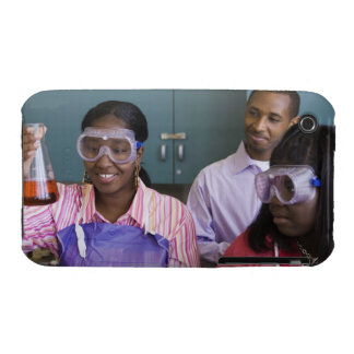 African teenage girl examining experiment in iPhone 3 covers