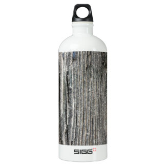 Aged wood fence posting from rustic bush setting SIGG traveller 1.0L water bottle