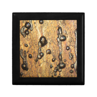 Air bubbles in ice under the microscope small square gift box