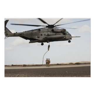 Air Force pararescuemen conduct a combat insert Poster