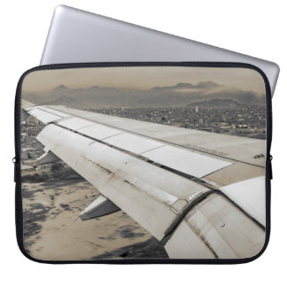 Airplane Arriving to Small Town Laptop Sleeve