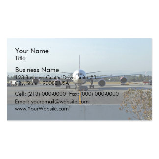 Airplane at airport with blue sky in background business card templates