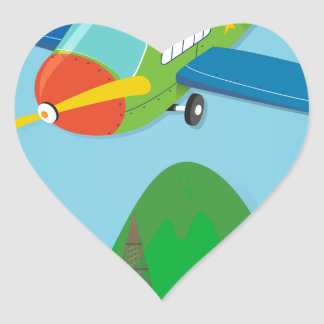 Airplane flying over a town heart sticker