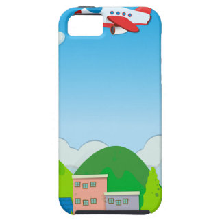 Airplane flying over buildings in suburb iPhone 5 cover