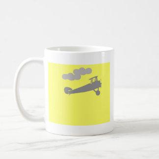 Airplane on plain blue background. mugs