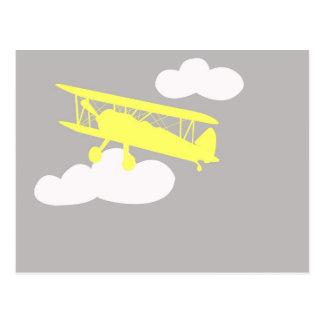 Airplane on plain grey background. postcard