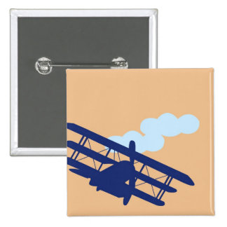 Airplane on plain orange background pinback button