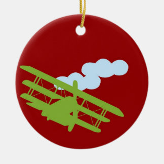 Airplane on plain red background. ornaments