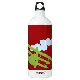 Airplane on plain red background. SIGG traveller 1.0L water bottle