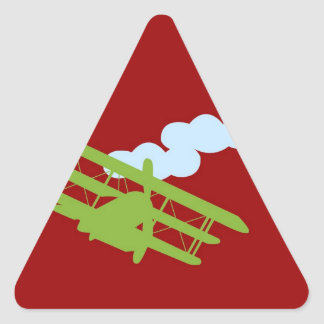 Airplane on plain red background. triangle sticker