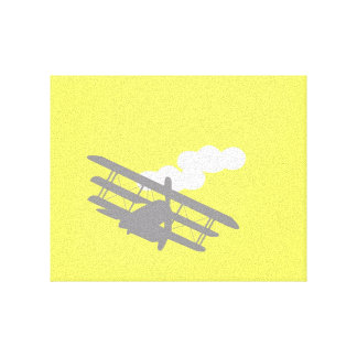 Airplane on plain yellow background. stretched canvas print