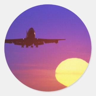 airplane sun round sticker