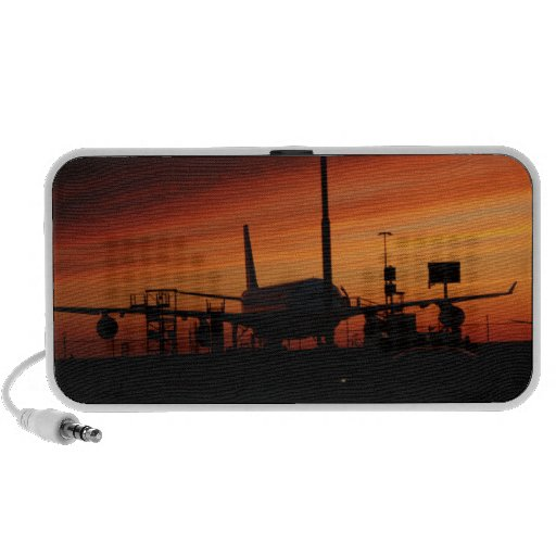Airplane under a vulcanic ash cloud ate sunset travelling speaker