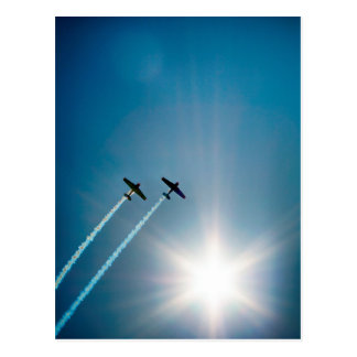 Airplanes Flying on Blue Sky with Sun. Postcard
