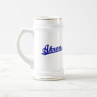 Akron  script logo in blue beer steins