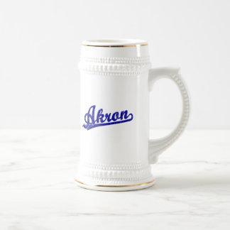 Akron  script logo in blue mugs