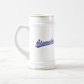Alameda script logo in blue coffee mugs
