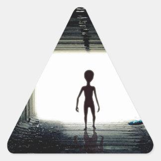 Alien Leaving Spaceship Triangle Sticker