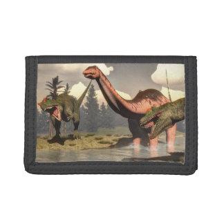 Allosaurus hunting big brontosaurus dinosaur trifold wallets
