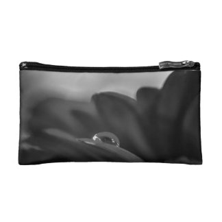 Alone a black and white water drop on Gerber Daisy Cosmetic Bag