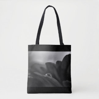 Alone a black and white water drop on Gerber Daisy Tote Bag