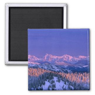 Alpenglow strikes the peaks of Glacier Magnet