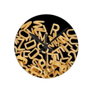 alphabet pasta background round clock